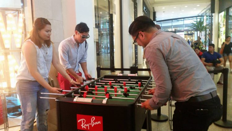 Look at who's playing over at the foosball table... Is that Victor Basa?